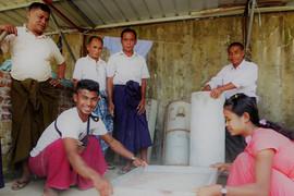 Community members making bio-sand filters