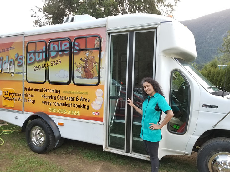 Sharan (owner/operator) and the mobile dog grooming van