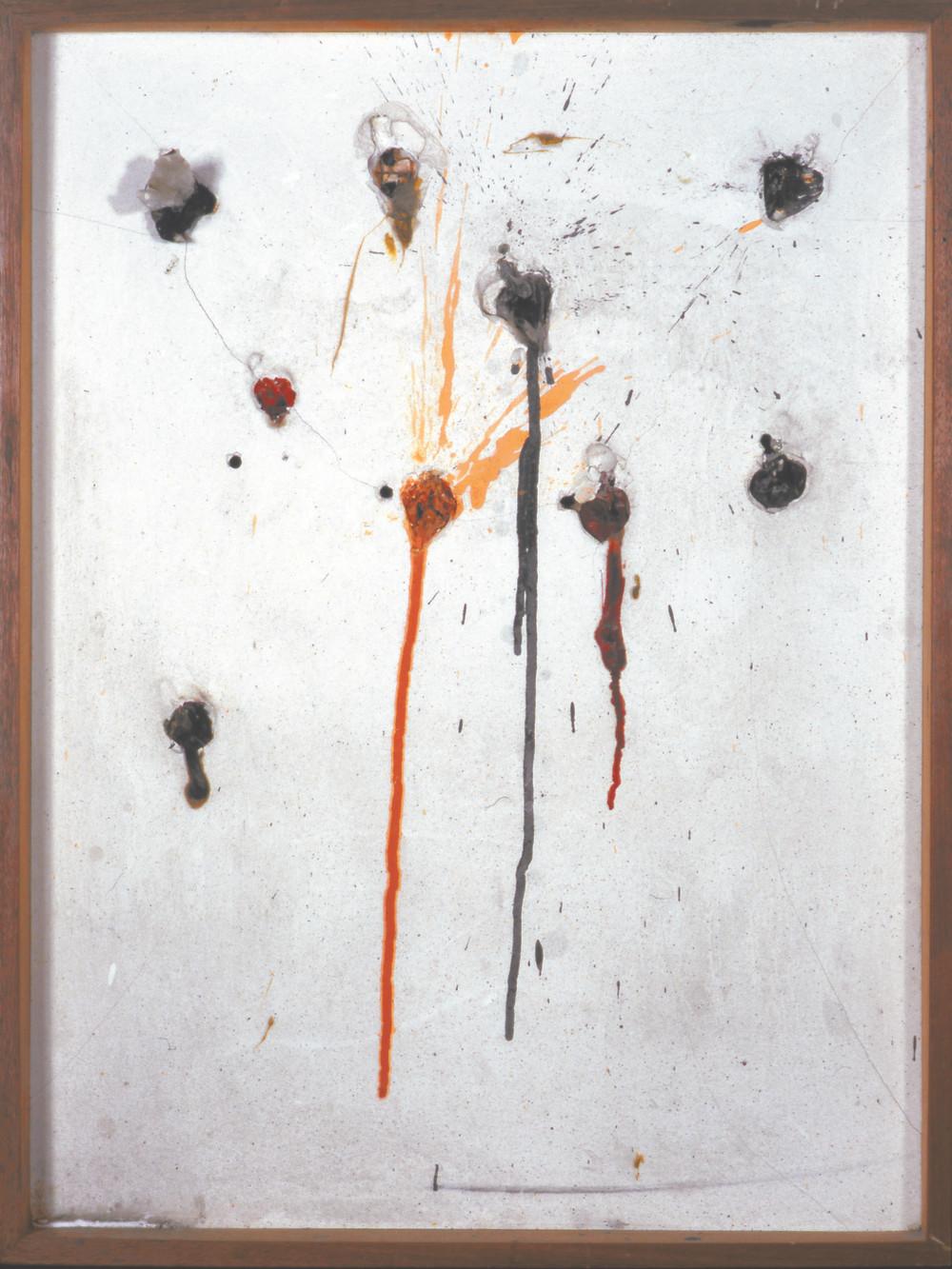 "Niki de Saint Phalle. Tir neuf trous—Edition MAT. 1964. Paint in plastic bags, embedded in plaster on  wood. 27 15/16 × 20 7/8"" (71 × 53.1 cm). Photo: NCAF Archives. © 2021 Niki Charitable Art Foundation"