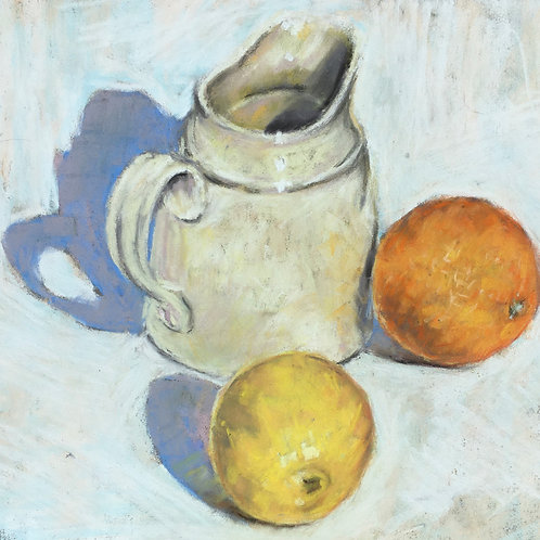 Jug with citrus fruit
