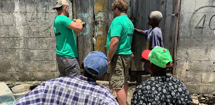 Repairing the door for blind man