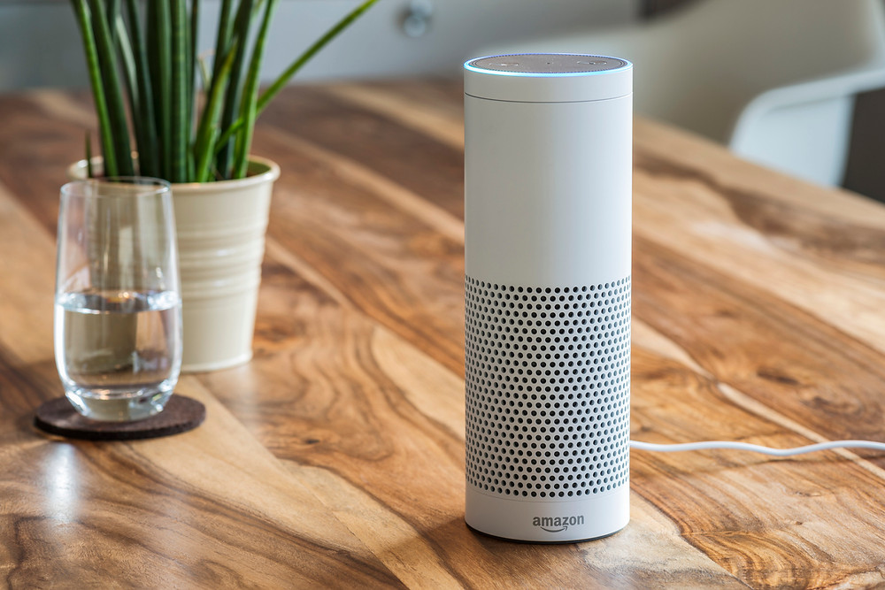 Activated Amazon Echo sitting on wooden dining table