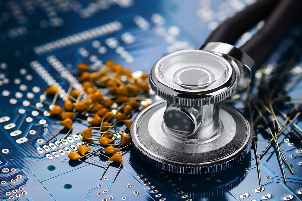medical stethoscope on motherboard with electronic components