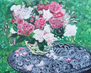 Roses in a Vase in the Garden