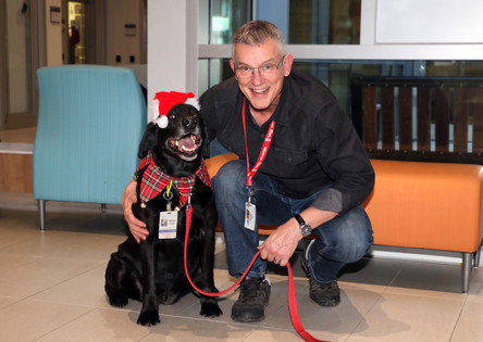 Halle the therapy dog and Roger Littlejohns