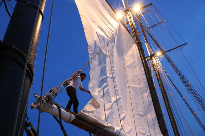 Crew members of the Empire Sandy, a three-masted schooner, give passengers a sailing experience on Canada's largest tallship.
