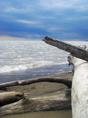 A brewing storm turns Lake Erie silver in Port Burwell beach