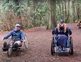 Two guests on a hike in Wheelchairs