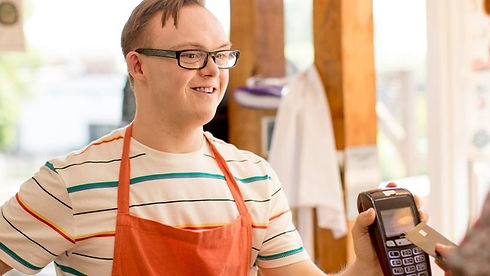 young-man-holding-credit-card-reader-in-coffee-shop_edited_edited.jpg