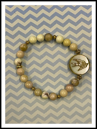 Yellow Jasper with Picasso bird bead