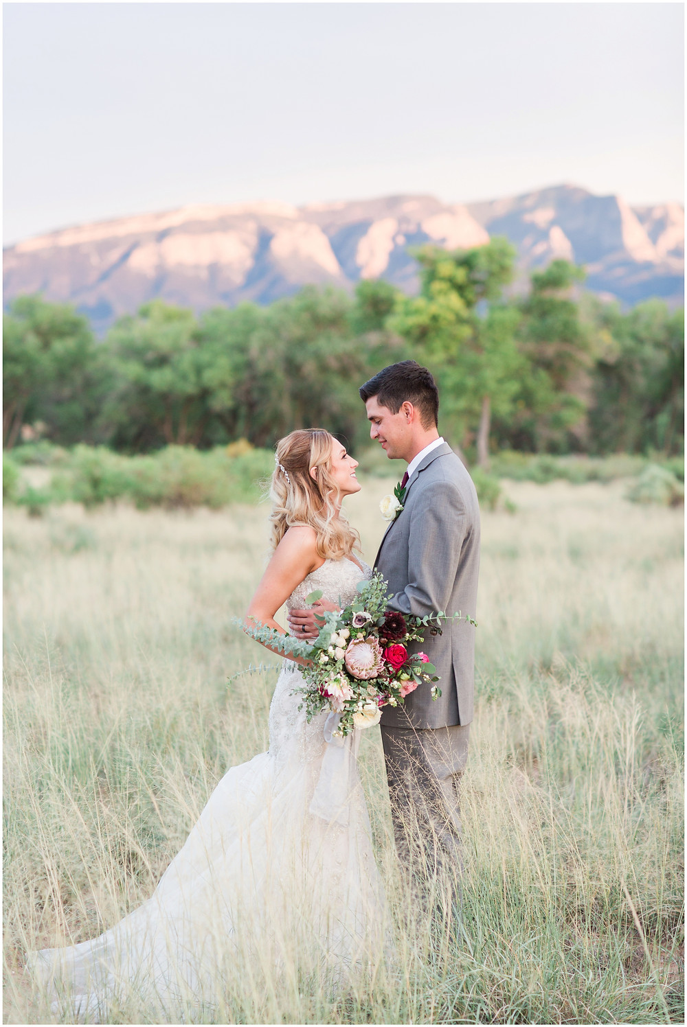 Wedding at Hyatt Tamaya. Outdoor wedding New Mexco. New Mexico Wedding photographer. maura Jane photography. burgundy wedding. bride and groom photos. sunset photos.
