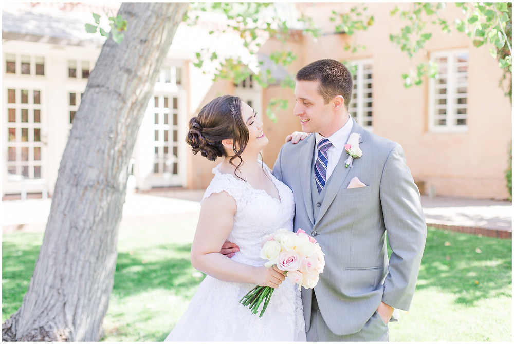 Los Poblanos wedding venue. Los Poblanos wedding. New Mexico wedding photographer. Albuquerque wedding photographer. Ballgown wedding dress. Pink rose bouquet. Elegant bouquet. Classic bouquet. Small bouquet. Glowy wedding photos.