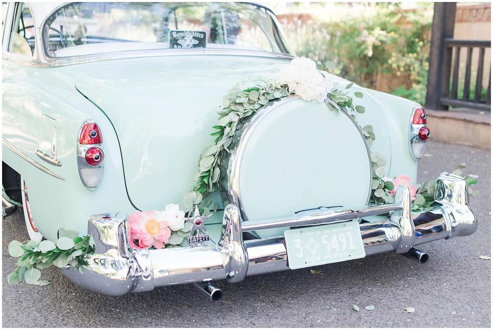 Wedding at Los poblanos. dusty blue wedding. new mexico wedding venue. outdoor wedding. spring wedding. albuquerque wedding. new mexico wedding photographer. maura jane photography. vintage wedding car. wedding getaway car.