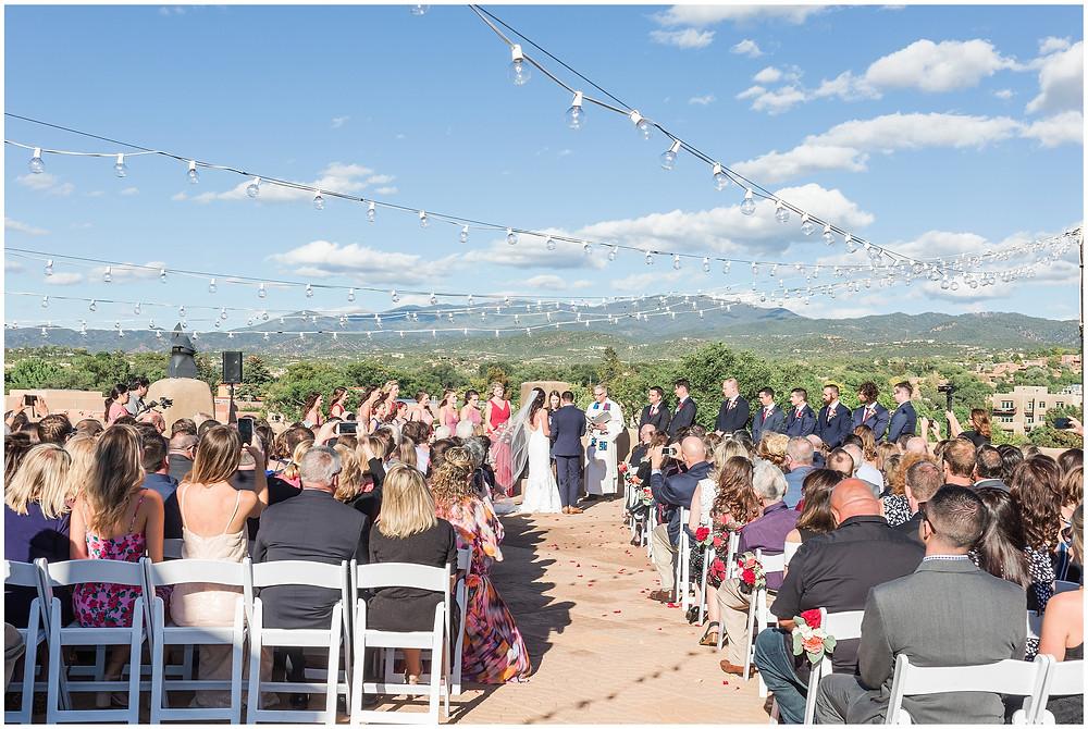 El Dorado Santa Fe. El Dorado Wedding. Santa Fe Wedding. Santa Fe Wedding Photographer. New Mexico Wedding. New Mexico Wedding Photographer. Lace Wedding Dress. Bold Bouquet. Bright Bouquet. Rose Bouquet. Weddings with a view. Rooftop Wedding.