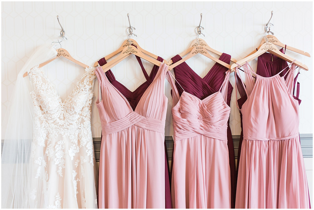 New Mexico wedding photographer. Albuquerque wedding photographer. Noahs event venue wedding. Pink and burgundy wedding. outdoor wedding portraits. pink and red bridesmaids dresses. brides hanger