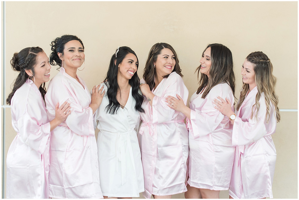 bride and bridesmaids in robes on wedding day. Bride tribe getting ready robes for Albuquerque wedding.