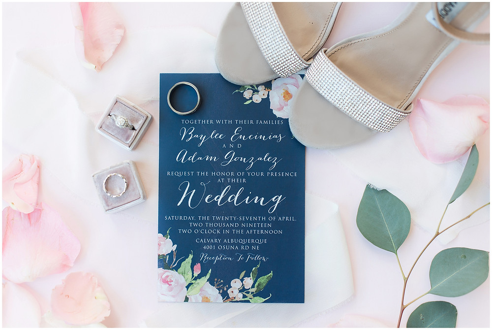Navy blue wedding invitation with halo engagement ring. Albuquerque wedding. Wedding day details with bridal shoes and wedding rings.