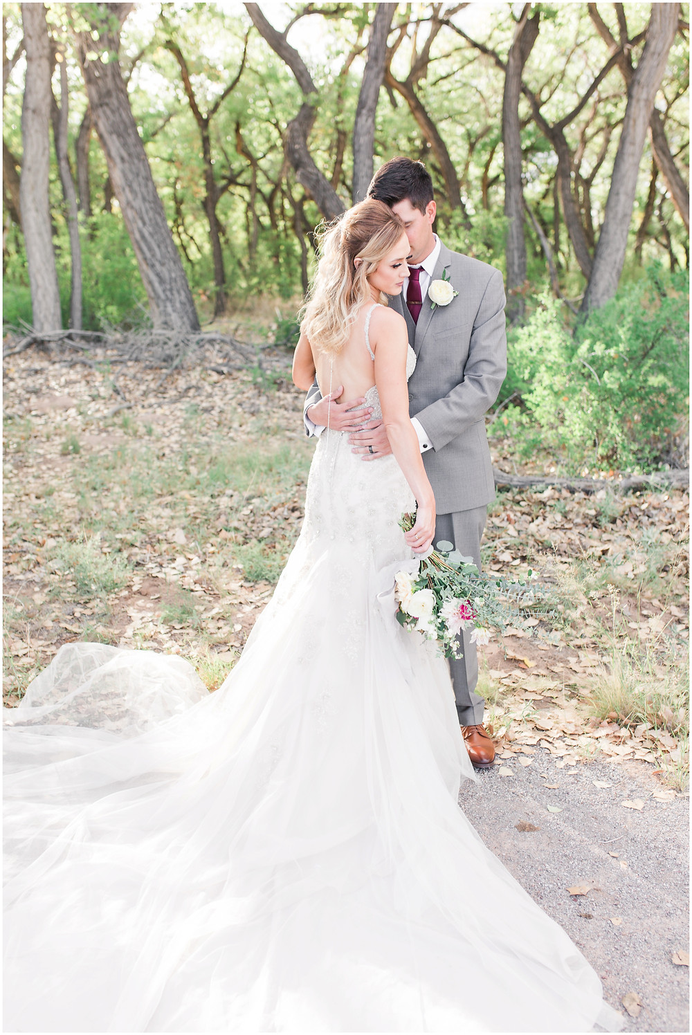 Wedding at Hyatt Tamaya. Outdoor wedding New Mexco. New Mexico Wedding photographer. maura Jane photography. burgundy wedding. bride and groom photos. backless wedding dress