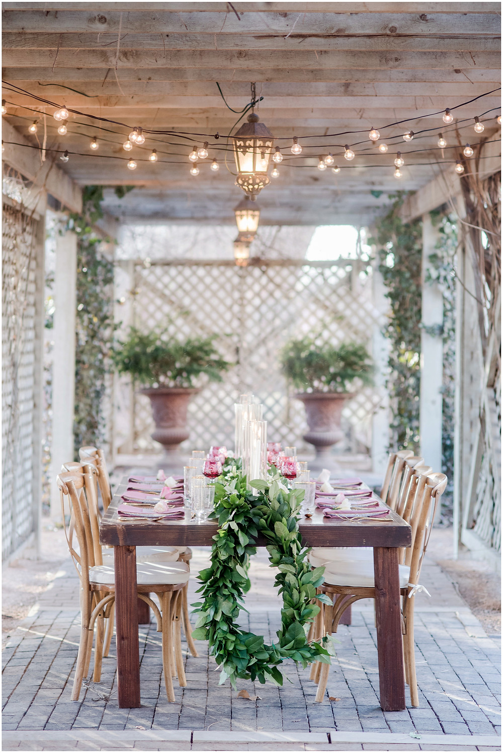 backyard reception idea. Backyard dinner party seating. Wedding reception table decor. Table garland. bistro light. backyard dinner ideas.