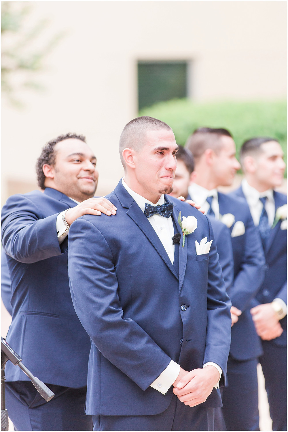 Grooms reaction to bride walking down the aisle.