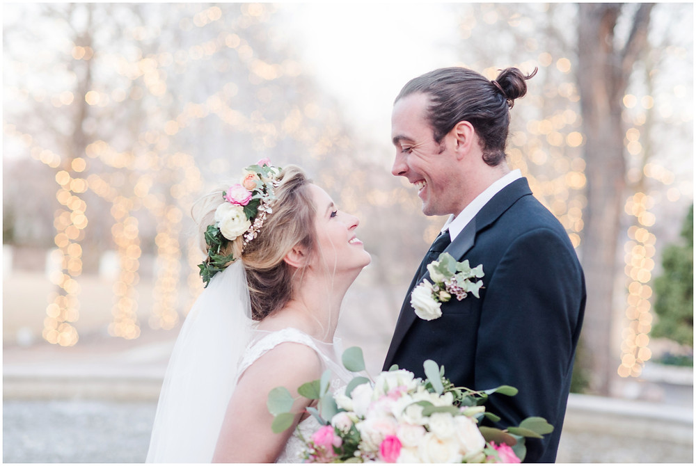 Estate wedding. Bridal tiara. Blonde bride. Green eye wedding make up. Big messy bouquet. bouquet with peonies and roses. groom with man bun. bride and groom portraits laughing.