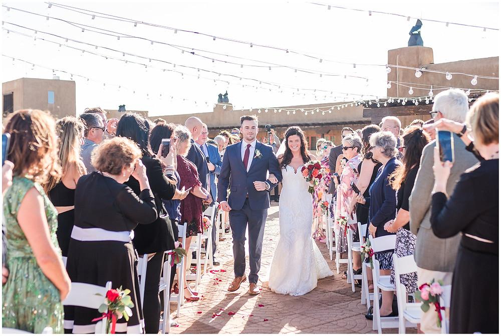 El Dorado Santa Fe. El Dorado Wedding. Santa Fe Wedding. Santa Fe Wedding Photographer. New Mexico Wedding. New Mexico Wedding Photographer. Lace Wedding Dress. Bold Bouquet. Bright Bouquet. Rose Bouquet. Rooftop Wedding.