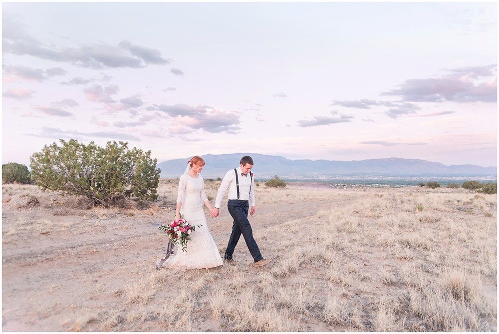 New Mexico Elopement. New Mexico Weding photographer. New Mexico wedding. Casa Parea wedding. Bright Pink wedding. Red Head Bride. Navy wedding. long sleeve wedding dress.