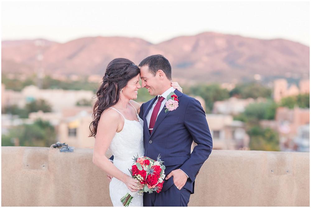 El Dorado Santa Fe. El Dorado Wedding. Santa Fe Wedding. Santa Fe Wedding Photographer. New Mexico Wedding. New Mexico Wedding Photographer. Lace Wedding Dress. Bold Bouquet. Bright Bouquet. Rose Bouquet. Rooftop Wedding. Sunset Wedding.