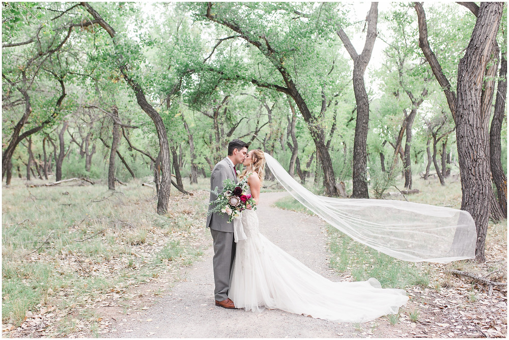 Wedding at Hyatt Tamaya. Outdoor wedding New Mexco. New Mexico Wedding photographer. maura Jane photography. burgundy wedding. bride and groom photos. veil shot. wedding veil
