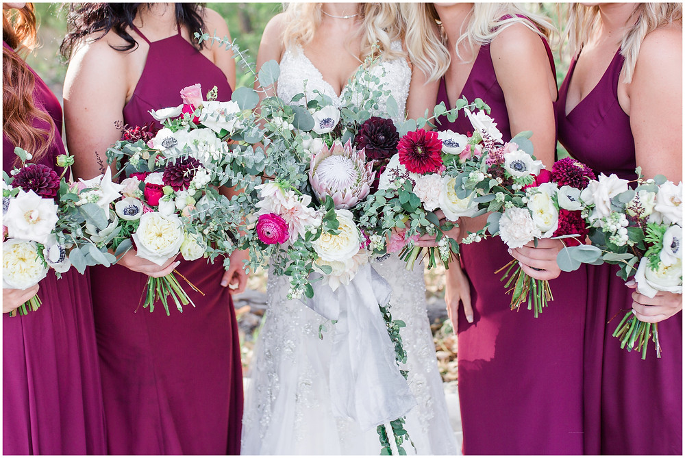 Wedding at Hyatt Tamaya. Outdoor wedding New Mexco. New Mexico Wedding photographer. maura Jane photography. burgundy wedding. messy bouquet. organic bouquet. overflowing wedding bouquet.