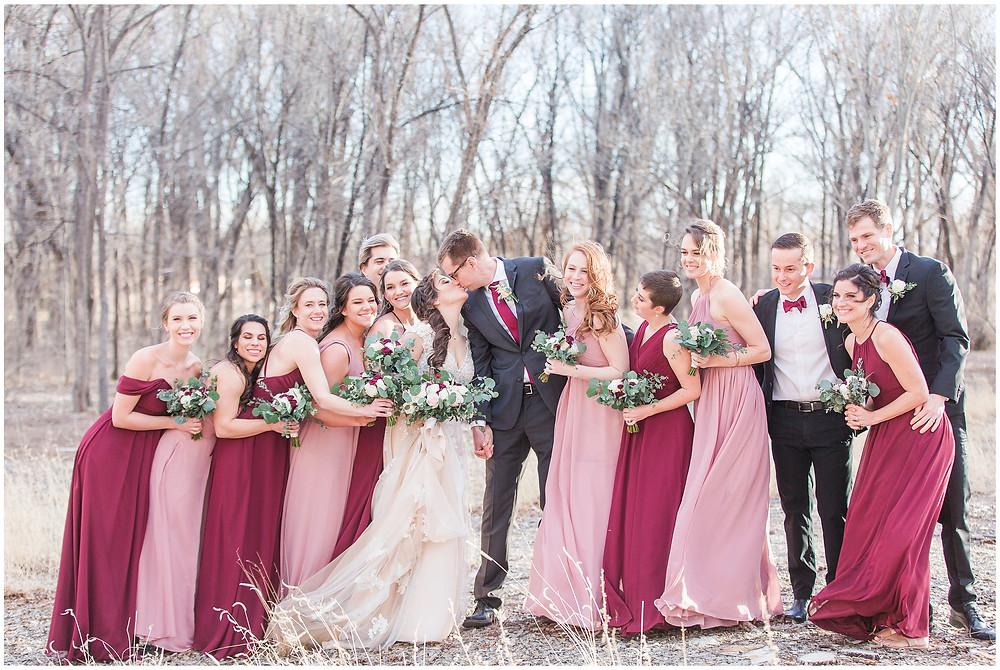 New Mexico wedding photographer. Albuquerque wedding photographer. Noahs event venue wedding. Pink and burgundy wedding. outdoor wedding portraits. bridal portraits. bridal hair and makeup. multicolored bridesmaids. pink and burgundy bridesmaids. mismatched bridesmaids. bridesmaids and groomsmen. bridal party