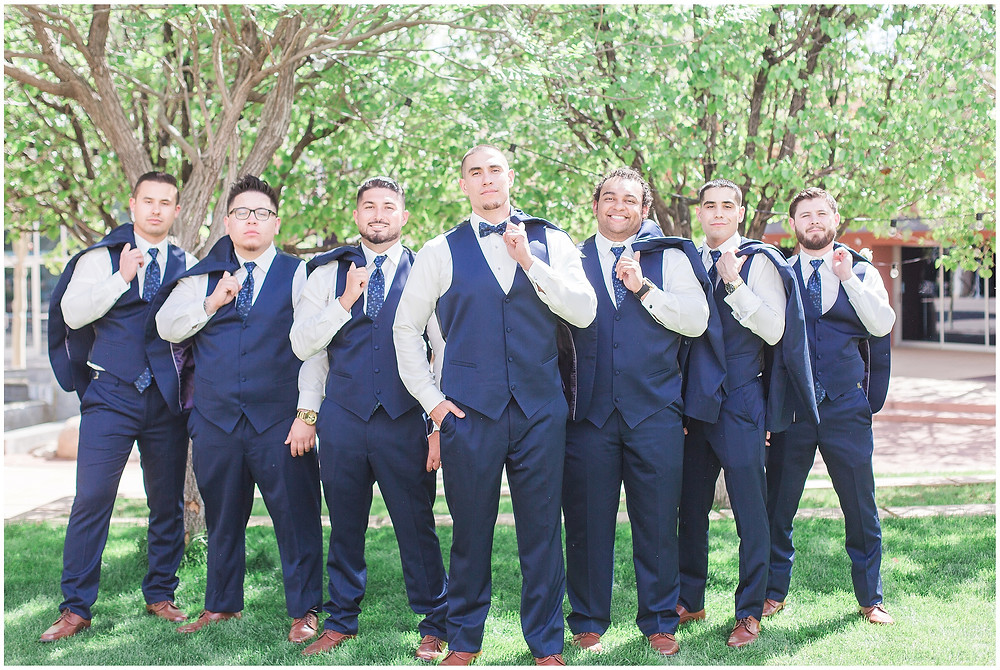 Navy blue groomsmen. Blue groomsmen outfits with brown oxford shoes.