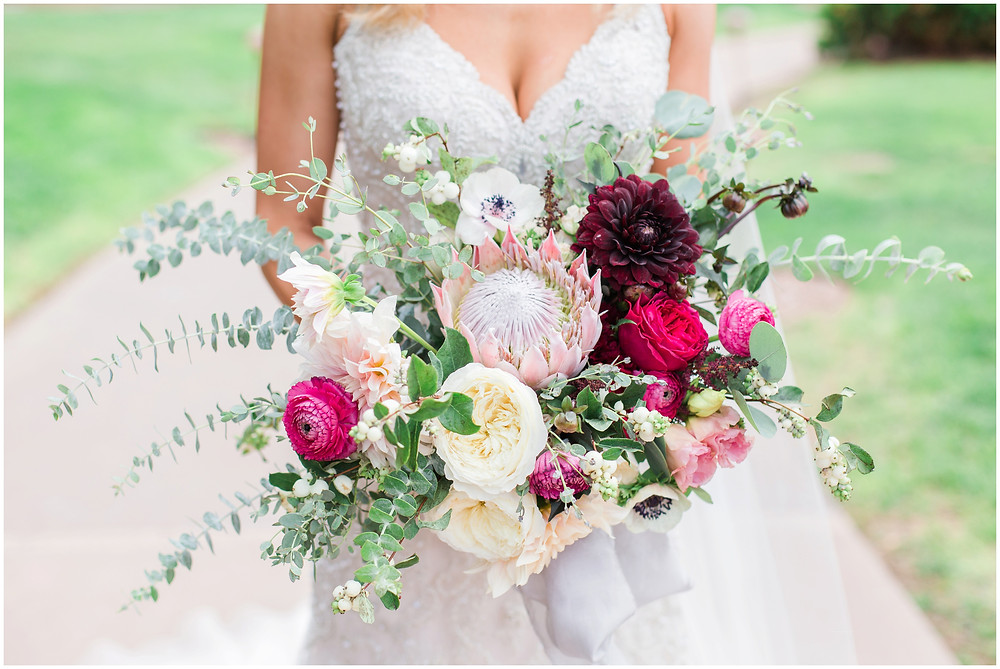 Wedding at Hyatt Tamaya. Outdoor wedding New Mexco. New Mexico Wedding photographer. maura Jane photography. burgundy wedding.  messy bouquet. organic bouquet. best wedding bouquets