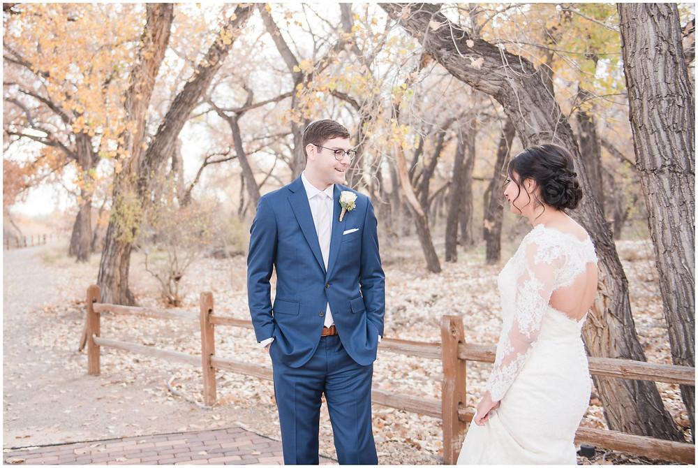 Wedding at Tamaya. New Mexico Wedding Photographer. Fall Wedding in Albuquerque. Maura Jane Photography. Long sleeve wedding dress. Winter wedding. Purple wedding bouquet. Mountain wedding photo. Fall wedding. Wedding first look
