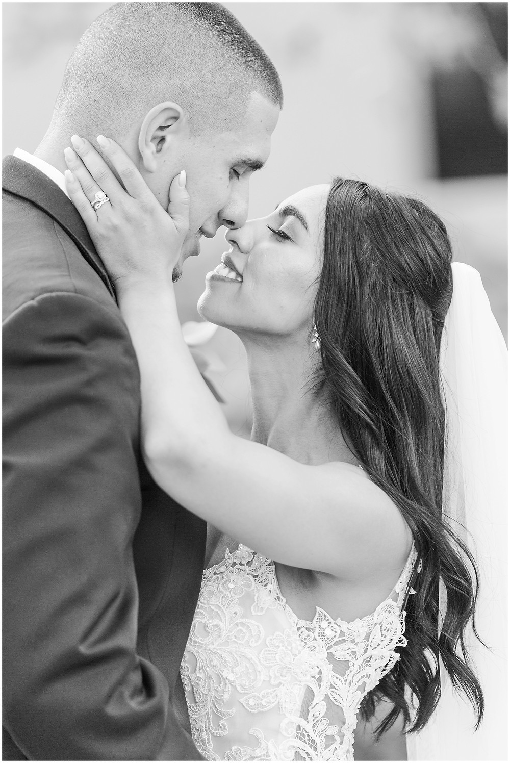 Black and white wedding photos. Bride and groom kissing after ceremony. Albuquerque wedding couple