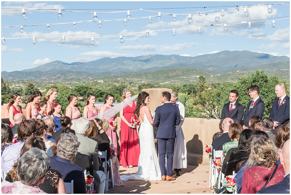 El Dorado Santa Fe. El Dorado Wedding. Santa Fe Wedding. Santa Fe Wedding Photographer. New Mexico Wedding. New Mexico Wedding Photographer. Lace Wedding Dress. Bold Bouquet. Bright Bouquet. Rose Bouquet. Rooftop Wedding. Mountain Wedding.