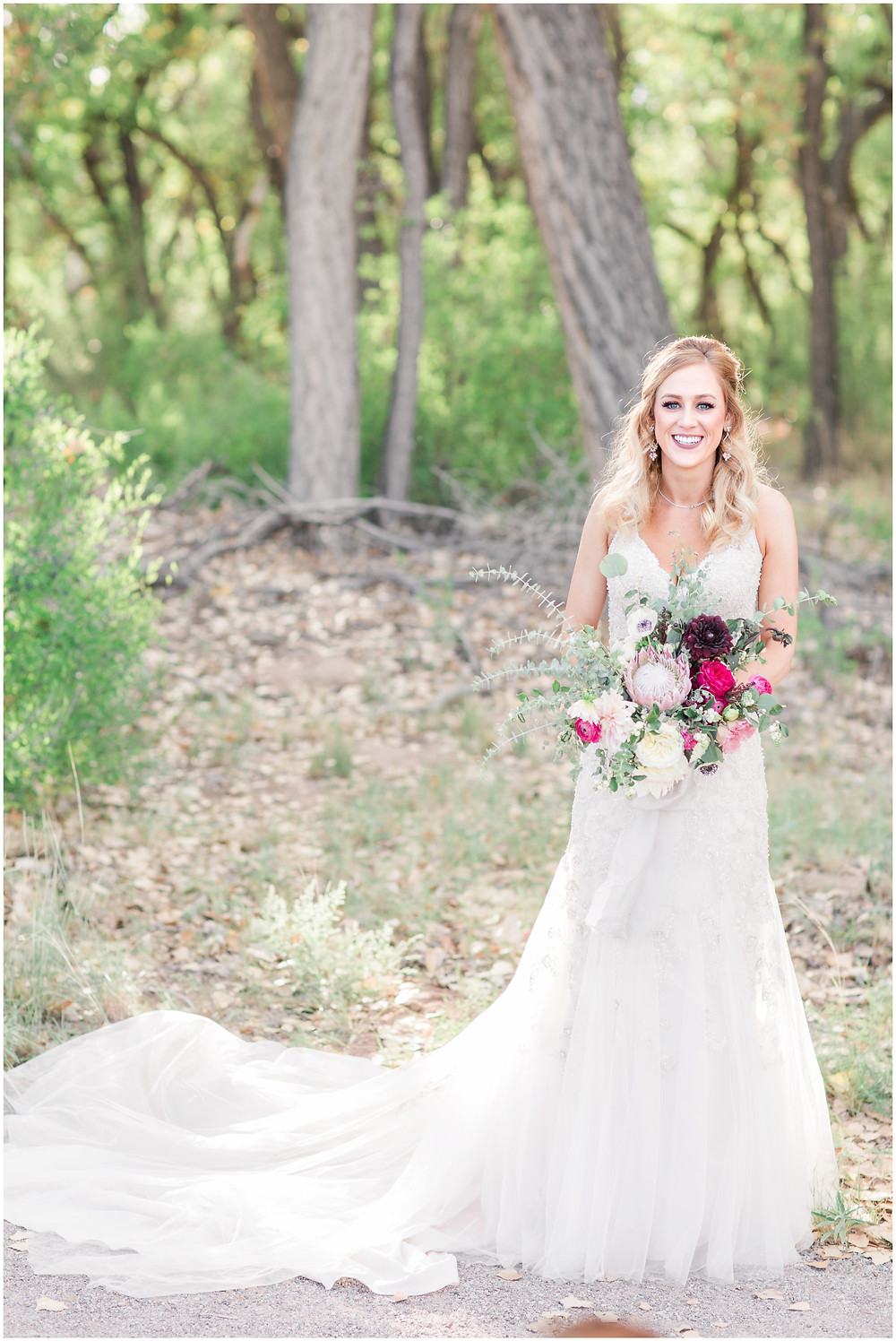 Wedding at Hyatt Tamaya. Outdoor wedding New Mexco. New Mexico Wedding photographer. maura Jane photography. burgundy wedding. organic bouquet. messy bouquet. wedding bouquet.