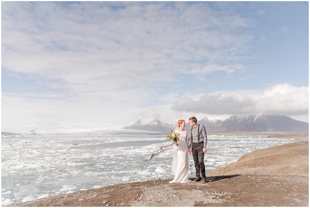 destination wedding photographer. Icelandic elopement. traveling wedding photographer. Icelandic bride. adventure wedding. adventure wedding photographer. blak sand beach wedding. icelandic waterfall wedding. glacier wedding