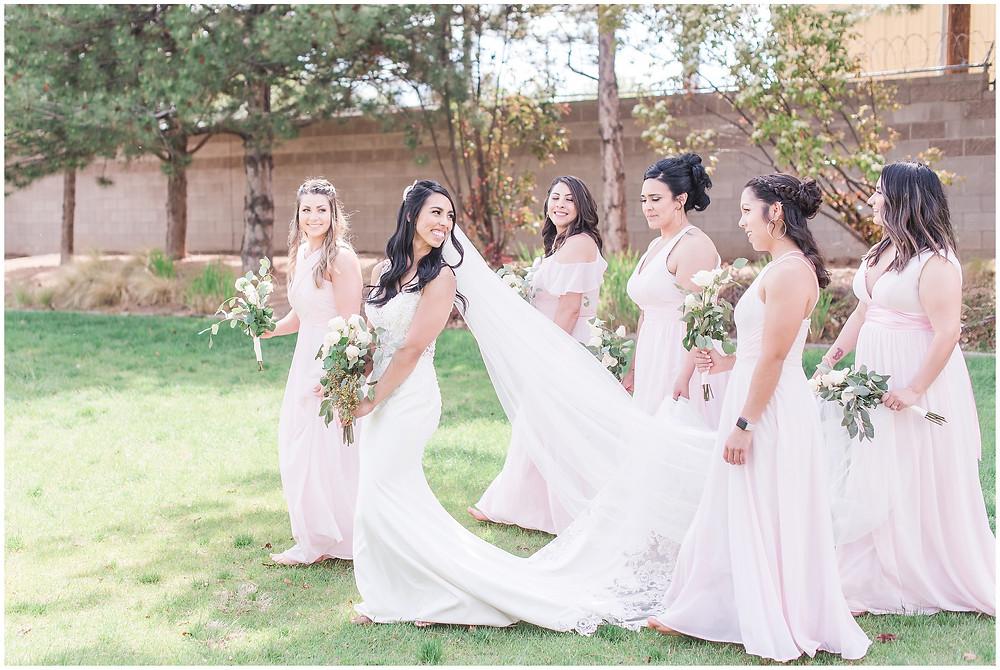bride and bridesmaids in pink. Albuquerque wedding at Calvary. Pink bridesmaids dresses