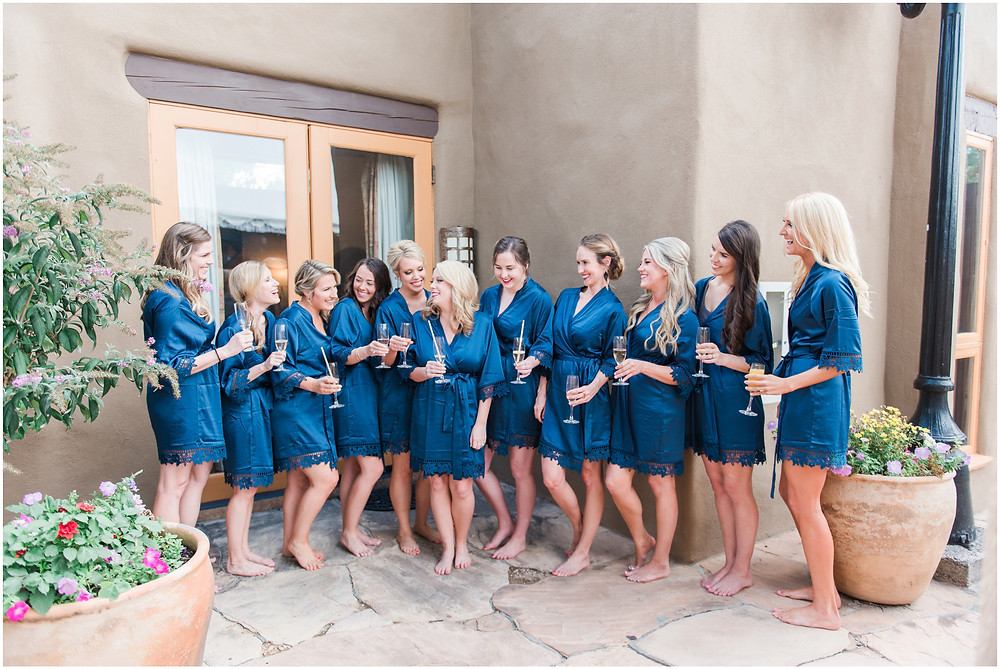 Wedding at La Posada. Santa Fe Wedding. Maura Jane Photography. New Mexico Wedding Photographer. Elegant wedding. Outdoor ceremony. Outdoor reception. bridesmaids robes.