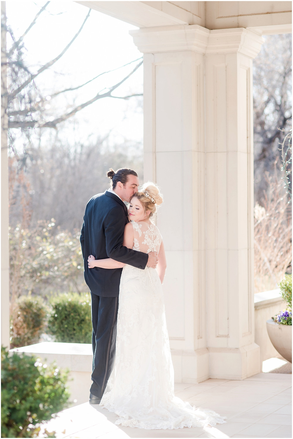 bride and groom portraits in Albuquerque. Groom with man bun. bridal tiara