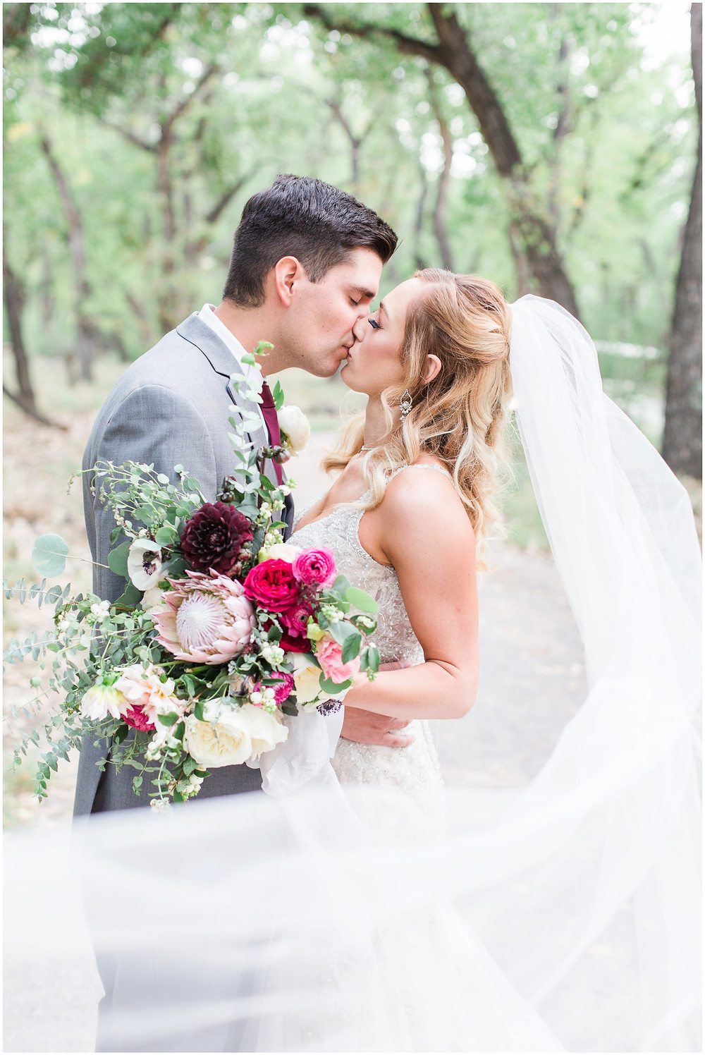 Wedding at Hyatt Tamaya. Outdoor wedding New Mexco. New Mexico Wedding photographer. maura Jane photography. burgundy wedding. bride and groom photos. wedding veil