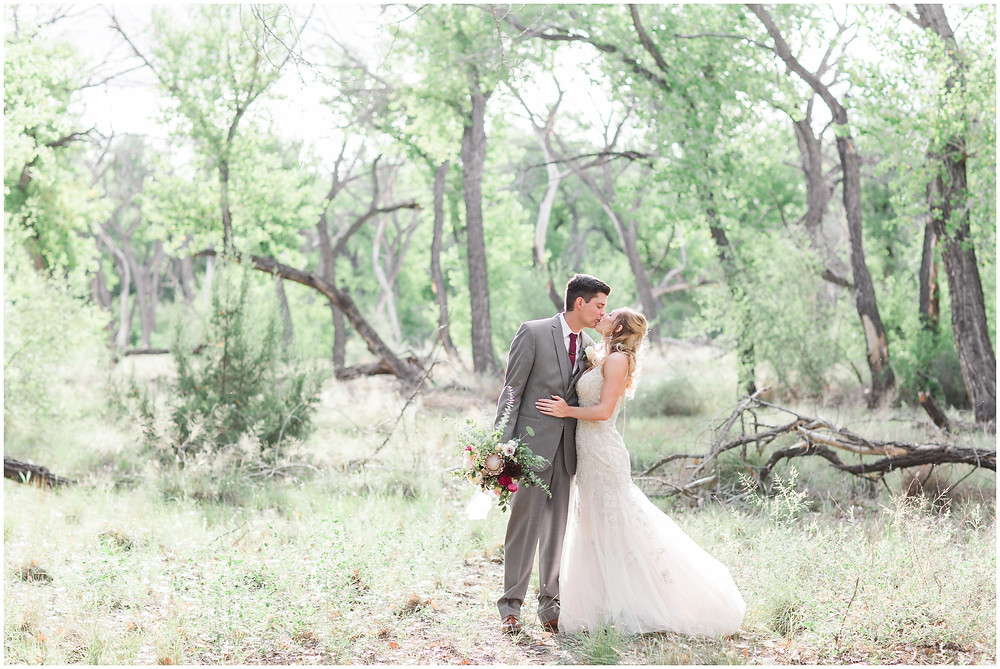 Wedding at Hyatt Tamaya. Outdoor wedding New Mexco. New Mexico Wedding photographer. maura Jane photography. burgundy wedding. bride and groom photos.
