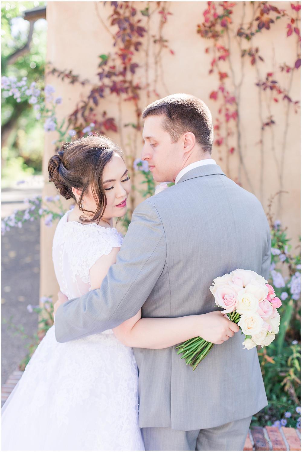 Los Poblanos wedding venue. Los Poblanos wedding. New Mexico wedding photographer. Albuquerque wedding photographer. Ballgown wedding dress. Pink rose bouquet. Elegant bouquet. Classic bouquet. Small bouquet. Adobe wedding.