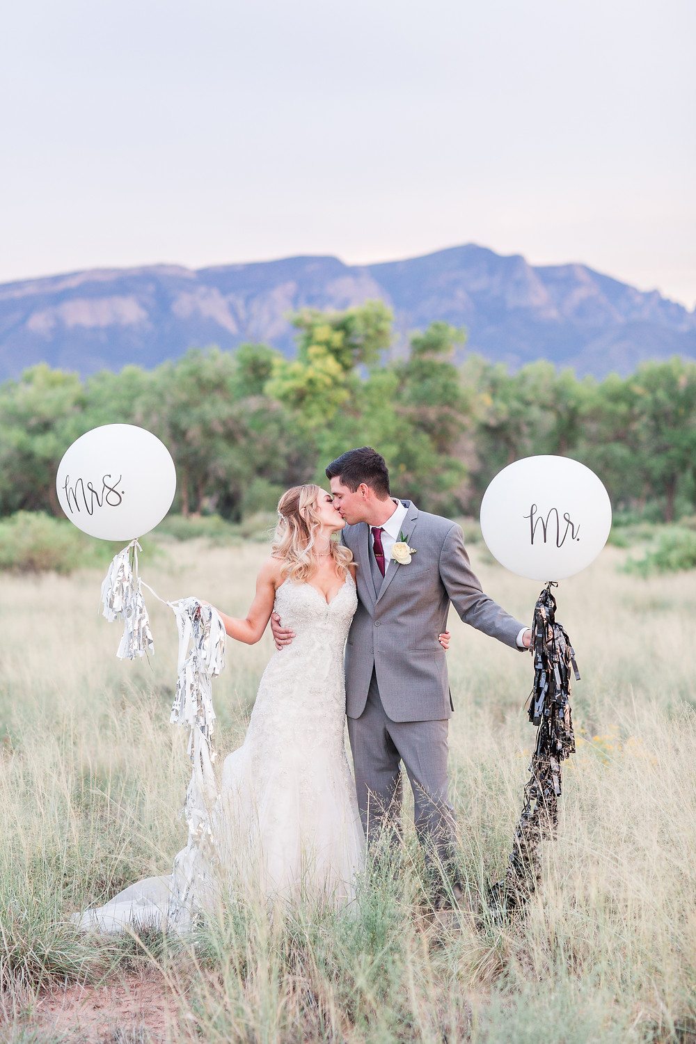 Wedding at Hyatt Tamaya. Outdoor wedding New Mexco. New Mexico Wedding photographer. maura Jane photography. burgundy wedding. bride and groom photos. sunset photos. mr and mrs balloon. kate spade wedding balloon