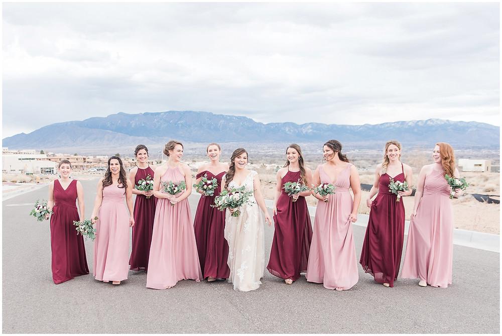 New Mexico wedding photographer. Albuquerque wedding photographer. Noahs event venue wedding. Pink and burgundy wedding. outdoor wedding portraits. bridal portraits. bridal hair and makeup. multicolored bridesmaids. pink and burgundy bridesmaids. mismatched bridesmaids.