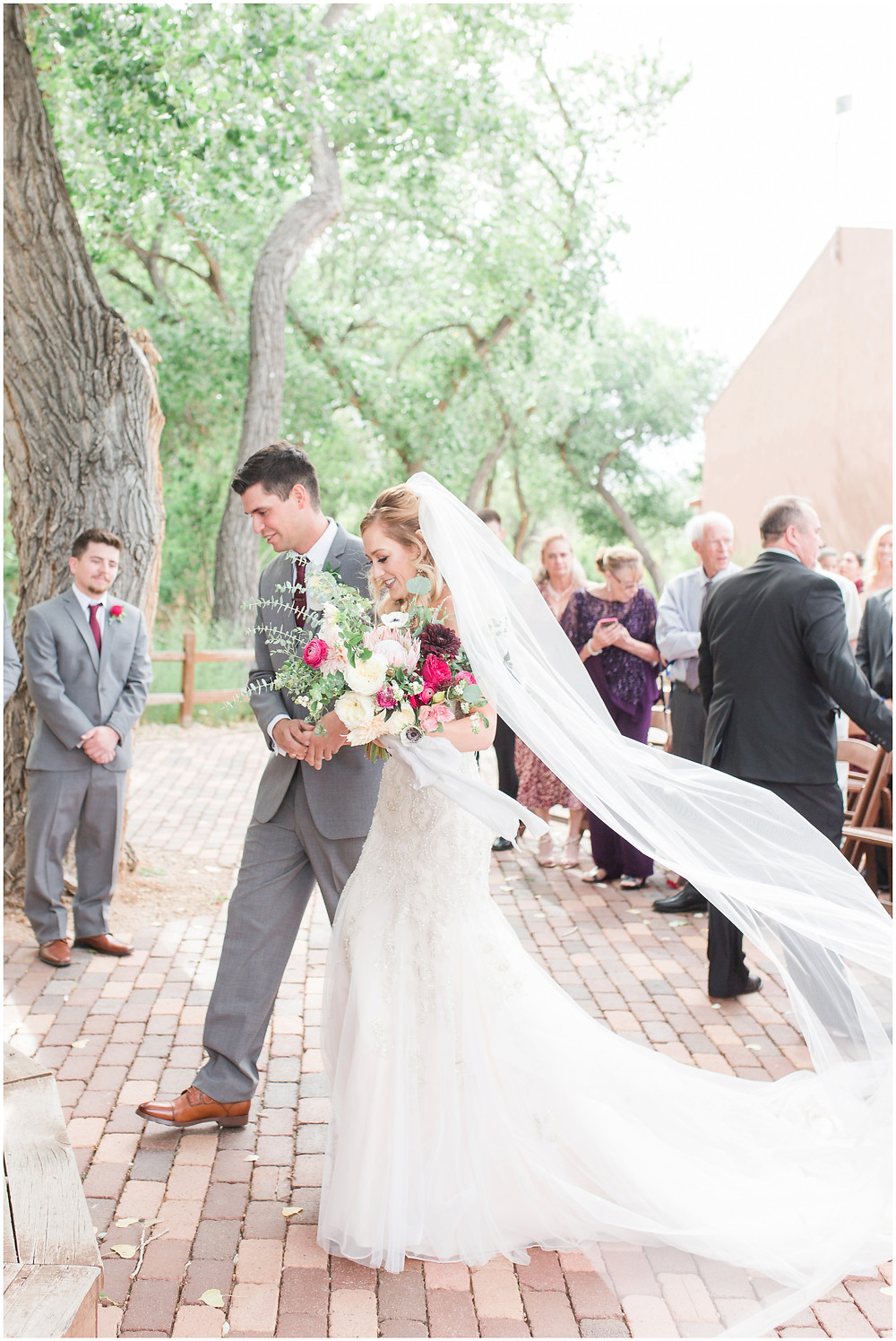 Wedding at Hyatt Tamaya. Outdoor wedding New Mexco. New Mexico Wedding photographer. maura Jane photography. burgundy wedding. outdoor ceremony.
