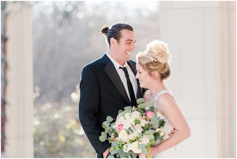 Bridal tiara. Blonde bride. Green eye wedding make up. Big messy bouquet. bouquet with peonies and roses. groom with man bun. bride and groom portraits laughing