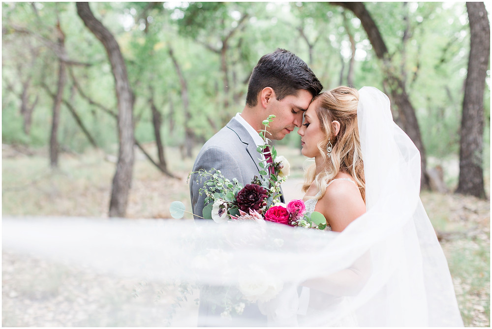 Wedding at Hyatt Tamaya. Outdoor wedding New Mexco. New Mexico Wedding photographer. maura Jane photography. burgundy wedding. bride and groom photos.  wedding veil. veil photos
