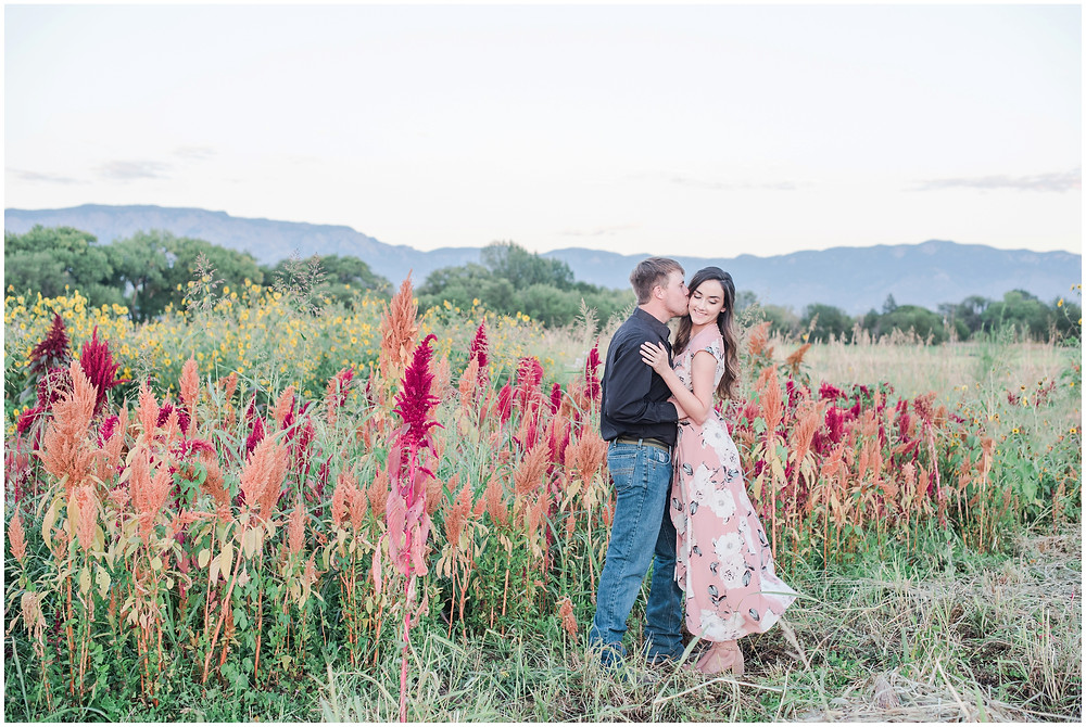 Wildflower engagement session. New mexico wedding photographer. Flower couples photos